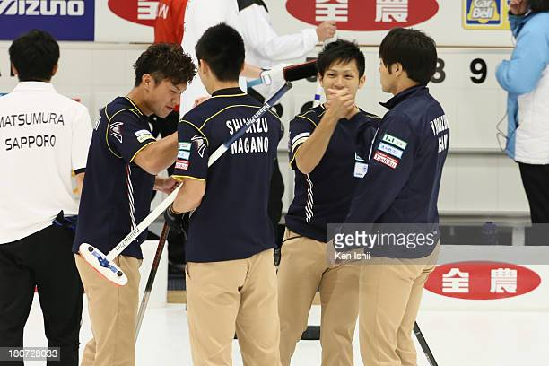Karuizawa team members celebrate after winning against Sapporo during Game Three of the Curling Japan Qualifying Tournament between SC Karuizawa and...