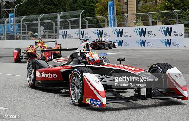 Karun Chandhok of India and Mahindra Racing Formula E Team leads during the FIA Formula E Putrajaya ePrix Championship race on November 22 2014 in...