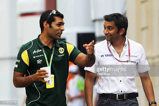 Karun Chandhok of India and Team Lotus and Narain Karthikeyan of India and Hispania Racing Team walk in the paddock following practice for the...