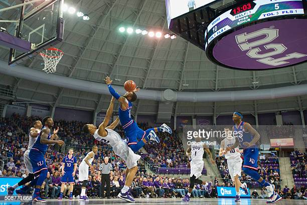 Karviar Shepherd of the TCU Horned Frogs draws a charge from Frank Mason III of the Kansas Jayhawks on February 6 2016 at the Ed and Rae Schollmaier...
