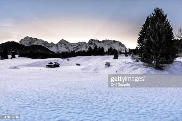 karwendel mountain range in winter - krün stock-fotos und bilder