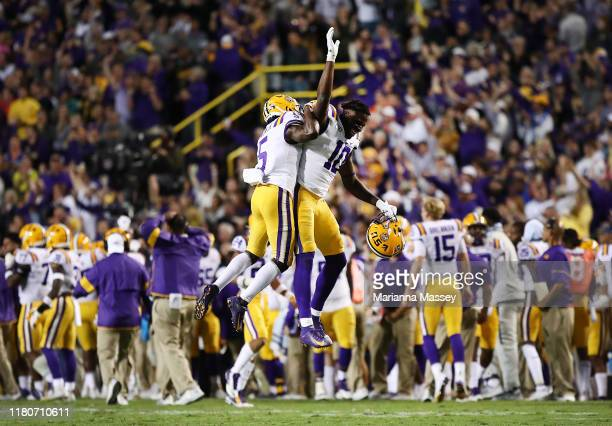 Kary Vincent Jr #5 and Stephen Sullivan of the LSU Tigers celebrate after their team scores during the fourth quarter against the Florida Gators at...