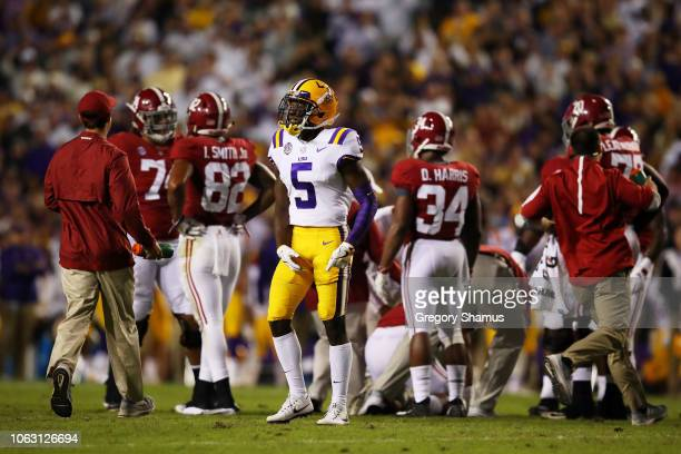 Kary Vincent Jr #5 of the LSU Tigers celebrates a sack that injured Tua Tagovailoa of the Alabama Crimson Tide in the first quarter of their game at...
