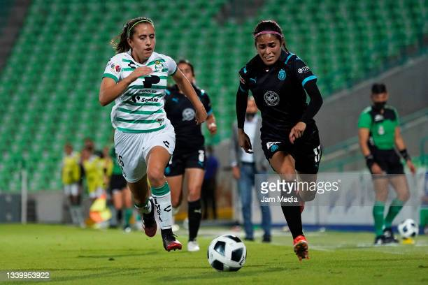 Karyme Martinez of Santos fights for the ball with Anette Vazquez of Chivas during a match between Santos and Chivas as part of the Torneo Grita...