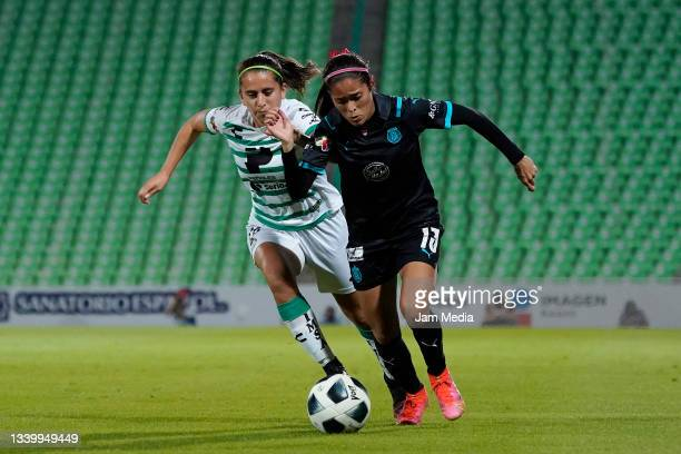Karyme Martinez of Santos fights for the ball with Joseline Montoya of Chivas during a match between Santos and Chivas as part of the Torneo Grita...