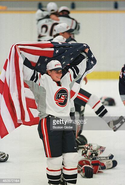 Karyn Bye celebrates the US women's hockey team victory wrapped in an American flag The US beat Canada to take the Olympic gold 31
