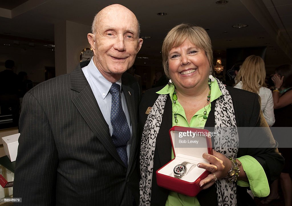 Karyn Dean with Apollo Astronaut General Thomas Stafford, left, shows the Omega watch she won as a door prize for attending a cocktail reception hosted by Omega at the I.W. Marks Jewelers on June 17, 2009 in Houston, Texas.