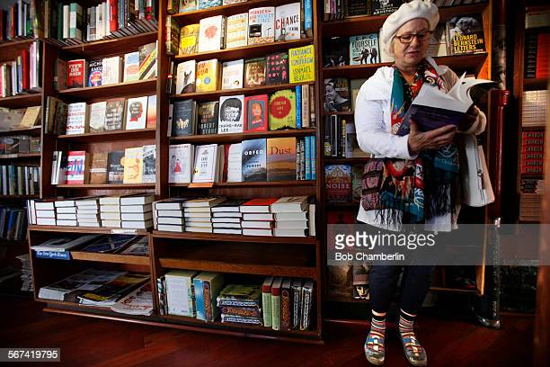 Karyn Noel takes a few moments to read through a copy of 'Infinite Jest' by David Foster Wallace at the City Lights Bookstore on MARCH 07 2014...