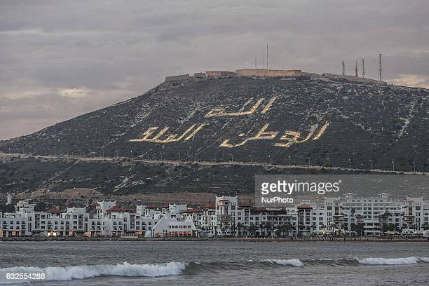 Kasbah hilltop with Believe in God and respect the King inscription is seen on 12 November 2011 in Agadir Morocco