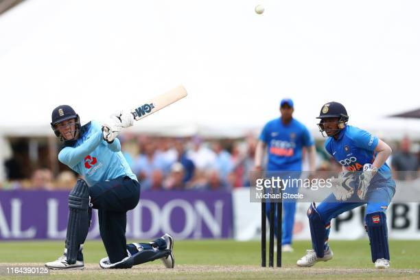 Kasey Aldridge of England hits to the legside boundary as India wicketkeeper Priyesh Patel looks on during the Under 19 TriSeries match between...