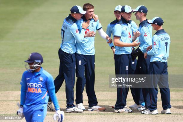 Kasey Aldridge of England is congratulated after taking the wicket of India's Priyam Garg during the Under 19 TriSeries match between England U19 and...