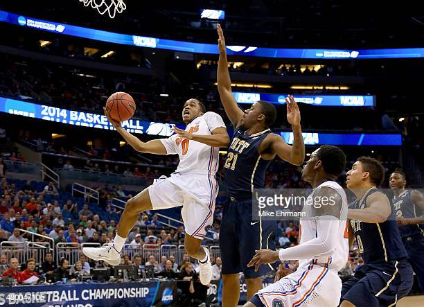 Kasey Hill of the Florida Gators goes up for a shot against Lamar Patterson of the Pittsburgh Panthers in the first half during the third round of...