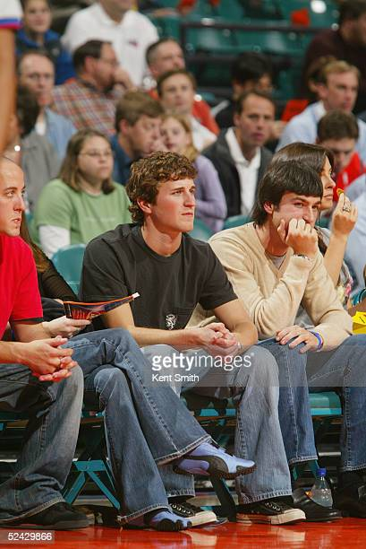 Kasey Kahne driver of Evernham Motorsports Dodge watches the game between the San Antonio Spurs and the Charlotte Bobcats at Charlotte Coliseum on...