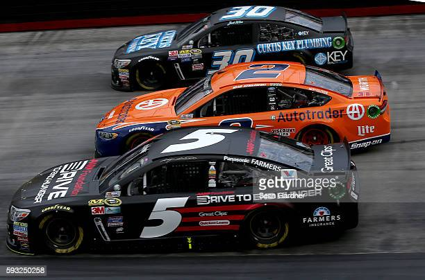 Kasey Kahne driver of the AARP Drive to End Hunger Chevrolet Brad Keselowski driver of the Autotrader Ford and Josh Wise driver of the Curtis Key...
