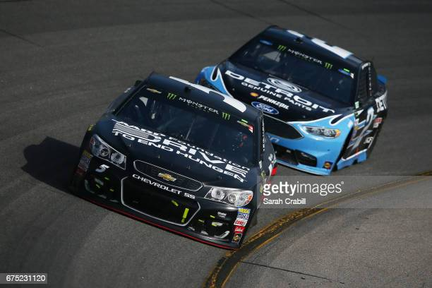 Kasey Kahne driver of the AARP Drive to End Hunger Chevrolet leads Brad Keselowski driver of the Detroit Genuine Parts Ford during the Monster Energy...