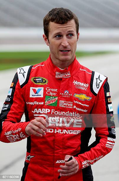Kasey Kahne driver of the AARP Drive to End Hunger Chevrolet stands on the grid during Salute to Veterans Qualifying Fueled by Texas Lottery for the...