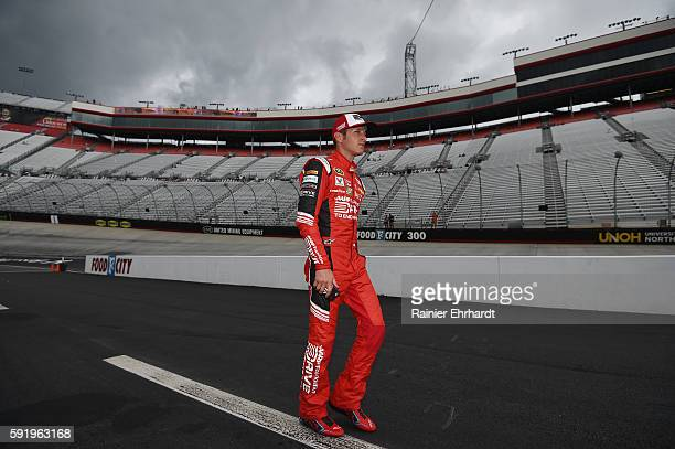 Kasey Kahne driver of the AARP Drive to End Hunger Chevrolet walks through the garage area during practice for the NASCAR Sprint Cup Series Bass Pro...