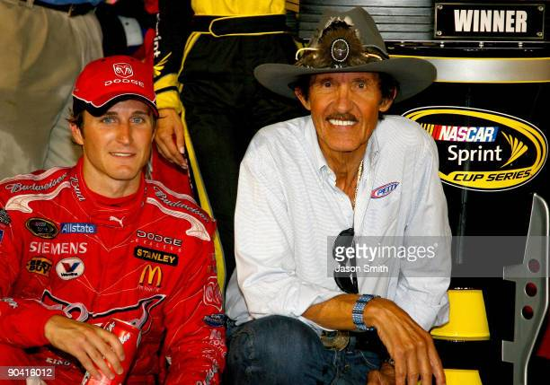 Kasey Kahne driver of the Budweiser Dodge and team owner Richard Petty celebrate in victory lane after winning the NASCAR Sprint Cup Series Pep Boys...