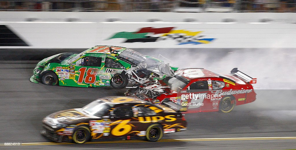Kasey Kahne, driver of the #9 Budweiser Dodge, crashes into the rear of Kyle Busch, driver of the #18 Interstate Batteries Toyota, after Kyle hit the wall on the final lap during the NASCAR Sprint Cup Series 51st Annual Coke Zero 400 at Daytona International Speedway on July 4, 2009 in Daytona Beach, Florida.
