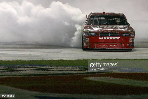Kasey Kahne driver of the Budweiser Dodge performs a burnout after winning the NASCAR Sprint Cup Series Pep Boys Auto 500 at Atlanta Motor Speedway...
