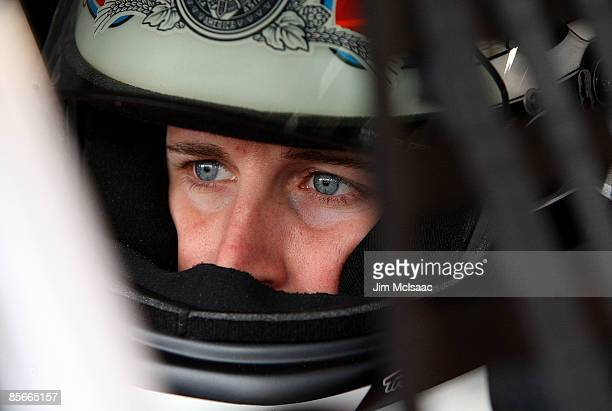 Kasey Kahne driver of the Budweiser Dodge sits in his car during practice for the NASCAR Sprint Cup Series Goody�s Fast Pain Relief 500 at the...