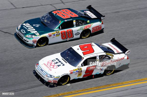 Kasey Kahne driver of the Budweiser Ford races Dale Earnhardt Jr driver of the AMP Energy/National Guard Chevrolet during the NASCAR Sprint Cup...