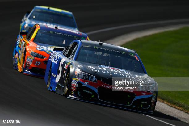 Kasey Kahne driver of the Chevrolet leads a pack of cars during the Monster Energy NASCAR Cup Series Brickyard 400 at Indianapolis Motorspeedway on...