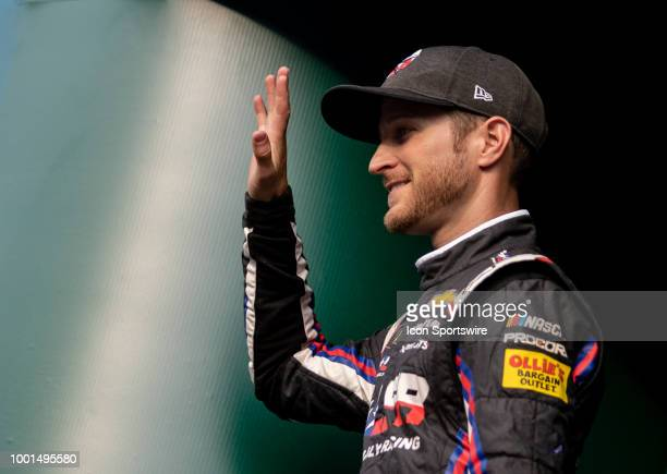 Kasey Kahne driver of the Dark Matter presented by Ionomy Chevrolet waves to the crowd during driver introductions before the Monster Energy NASCAR...
