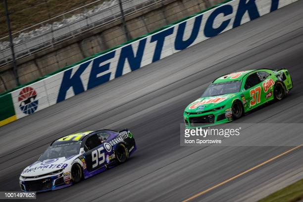 Kasey Kahne driver of the Dark Matter presented by Ionomy Chevrolet leads Chris Buescher driver of the Gain Chevrolet coming off turn four in the...