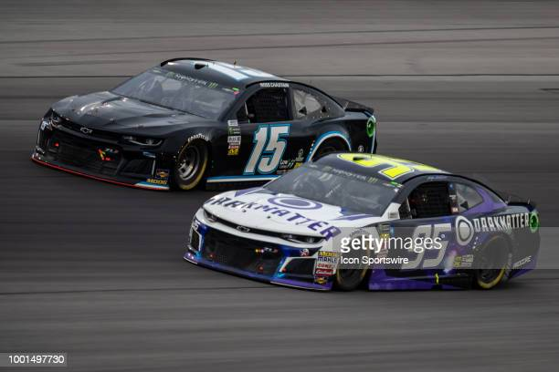 Kasey Kahne driver of the Dark Matter presented by Ionomy Chevrolet passes Ross Chastain driver of the Chevrolet on the inside off turn four in the...