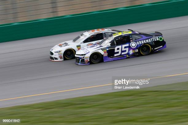 Kasey Kahne driver of the Dark Matter presented by Ionomy Chevrolet races David Ragan driver of the MDS Transport Ford during the Monster Energy...