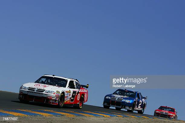 Kasey Kahne, driver of the Dodge Dealers/UAW Dodge, leads Kurt Busch, driver of the Miller Lite Dodge, during the NASCAR Nextel Cup Series...