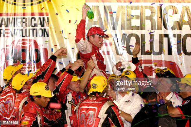 Kasey Kahne driver of the Evernham Motorsports Dodge celebrates in Victory Lane after winning the NASCAR Nextel Cup Series Chevy American Revolution...