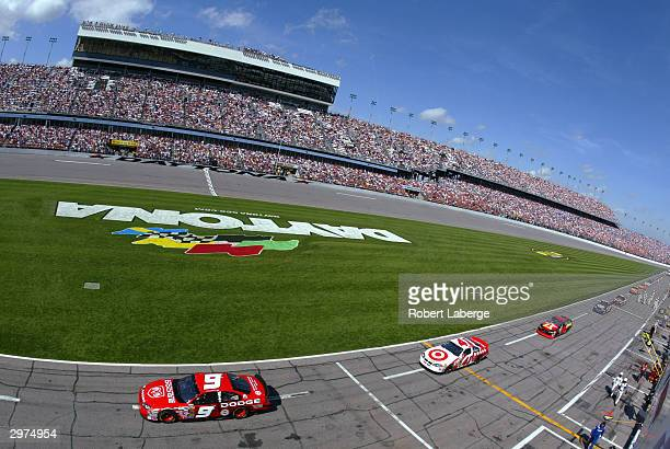 Kasey Kahne driver of the Evernham Motorsports Dodge Dealers/UAW Dodge leads Casey Cears in his Target Chip Ganassi Racing Dodge and Jamie McMurray...