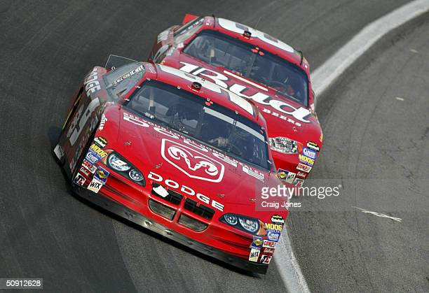 Kasey Kahne driver of the Evernham Motorsports Dodge leads Dale Earnhardt Jr driver of the Budweiser Chevrolet during the CocaCola 600 on May 30 2004...