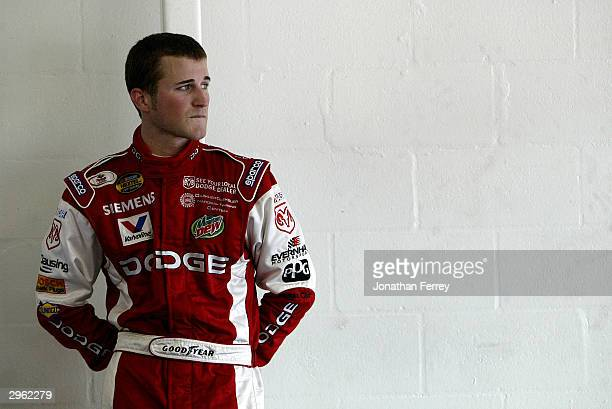Kasey Kahne driver of the Evernham Motorsports Dodge stands during practice for the NASCAR Nextel Cup Daytona 500 on February 10 2004 at Daytona...