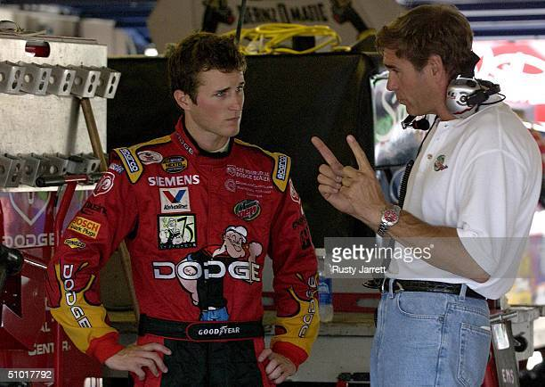 Kasey Kahne driver of the Evernham Motorsports Dodge talks with car owner Ray Evernham in the garage during practice for the Pepsi 400 July 1 2004 at...