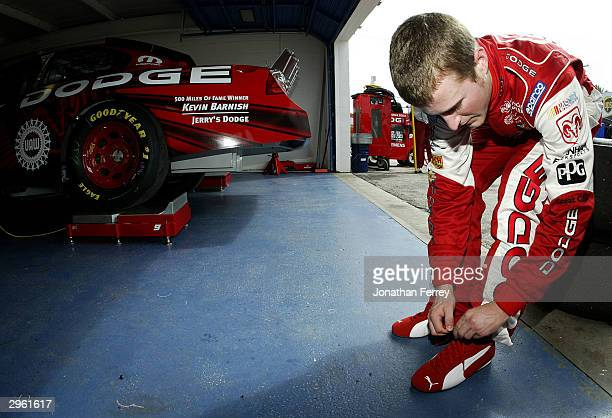 Kasey Kahne driver of the Evernham Motorsports Dodge ties his shoelece during practice for the NASCAR Nextel Cup Daytona 500 on February 10 2004 at...