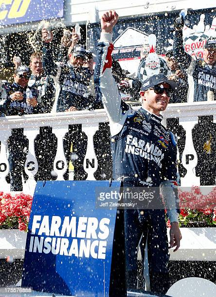 Kasey Kahne, driver of the Farmers Insurance Chevrolet, celebrates in victory lane after winning the NASCAR Sprint Cup Series GoBowling.com 400 at...