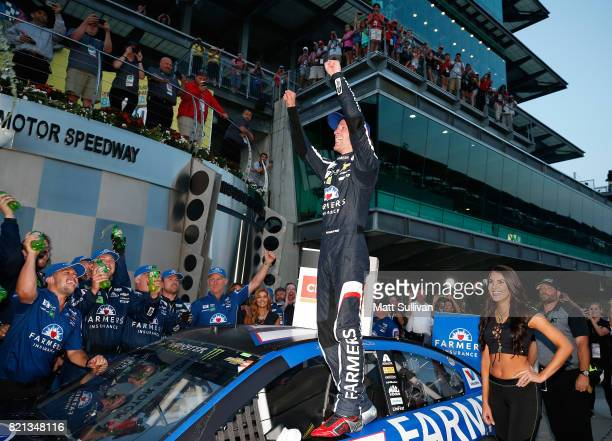 Kasey Kahne driver of the Farmers Insurance Chevrolet celebrates in Victory Lane after winning the Monster Energy NASCAR Cup Series Brickyard 400 at...