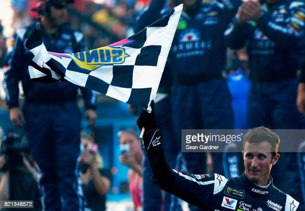 Kasey Kahne driver of the Farmers Insurance Chevrolet celebrates winning the Monster Energy NASCAR Cup Series Brickyard 400 at Indianapolis...