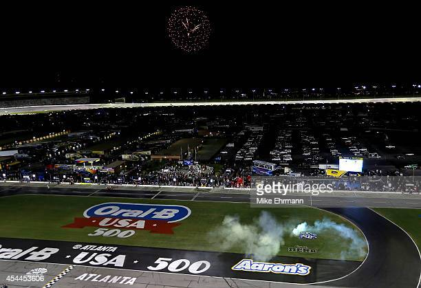 Kasey Kahne driver of the Farmers Insurance Chevrolet celebrates with a burnout after winning the NASCAR Sprint Cup Series OralB USA 500 at Atlanta...