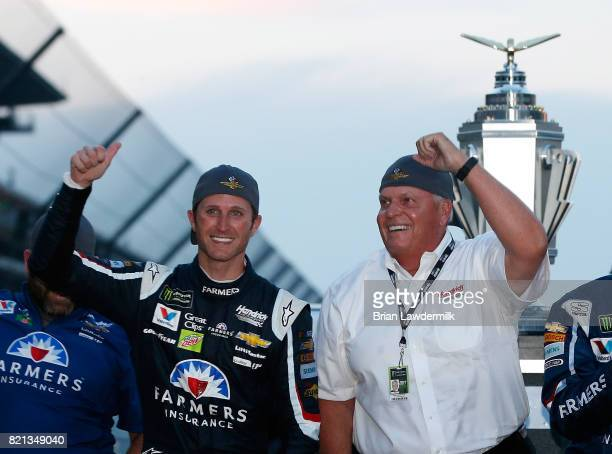 Kasey Kahne driver of the Farmers Insurance Chevrolet celebrates with team owner Rick Hendrick and his crew after winning the Monster Energy NASCAR...