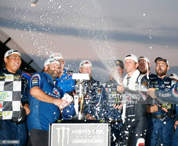 Kasey Kahne driver of the Farmers Insurance Chevrolet celebrates with his crew after winning the Monster Energy NASCAR Cup Series Brickyard 400 at...