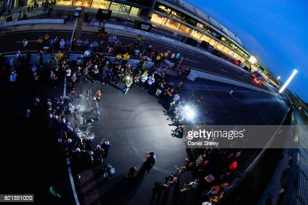 Kasey Kahne driver of the Farmers Insurance Chevrolet celebrates with the trophy after winning the Monster Energy NASCAR Cup Series Brickyard 400 at...