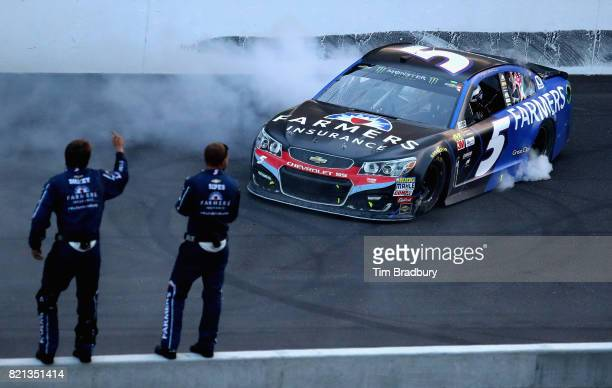 Kasey Kahne driver of the Farmers Insurance Chevrolet celebrates with a burnout after winning the Monster Energy NASCAR Cup Series Brickyard 400 at...