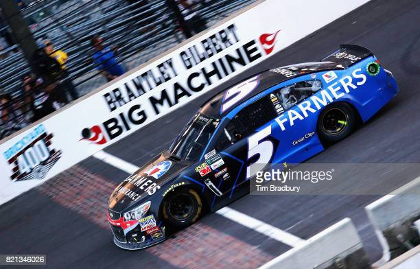 Kasey Kahne driver of the Farmers Insurance Chevrolet crosses the finish line to win the Monster Energy NASCAR Cup Series Brickyard 400 at...