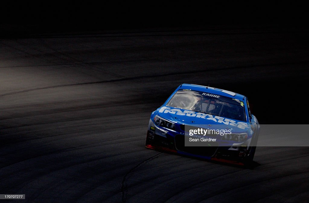Kasey Kahne, driver of the #5 Farmers Insurance Chevrolet, drives through turn one during the NASCAR Sprint Cup Series Quicken Loans 400 at Michigan International Speedway on June 16, 2013 in Brooklyn, Michigan.