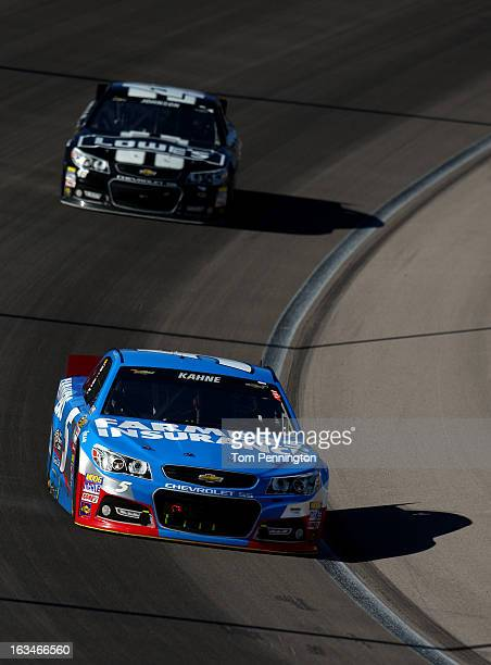 Kasey Kahne driver of the Farmers Insurance Chevrolet leads Jimmie Johnson driver of the Lowe's/Kobalt Tools Chevrolet during the NASCAR Sprint Cup...