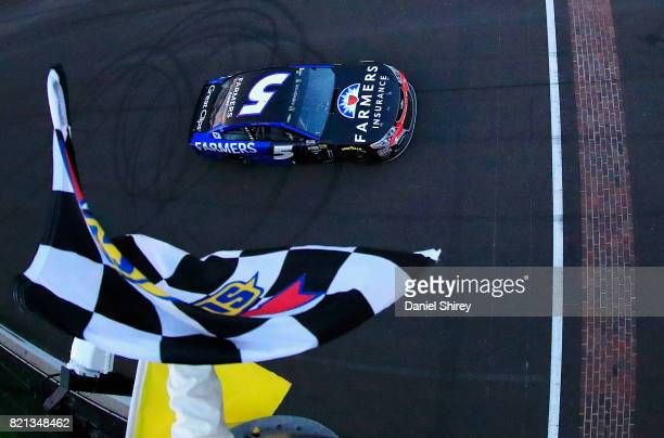 Kasey Kahne driver of the Farmers Insurance Chevrolet takes the checkered flag under caution to win the Monster Energy NASCAR Cup Series Brickyard...